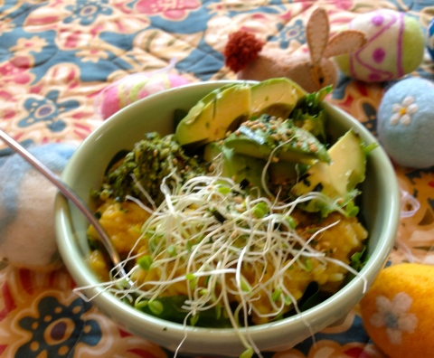 Kitchari with greens and sprouts and avocado.